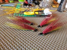 "Some Purplish/Chartreuse Clousers (I like the call the color combo, ""The Joker"")."